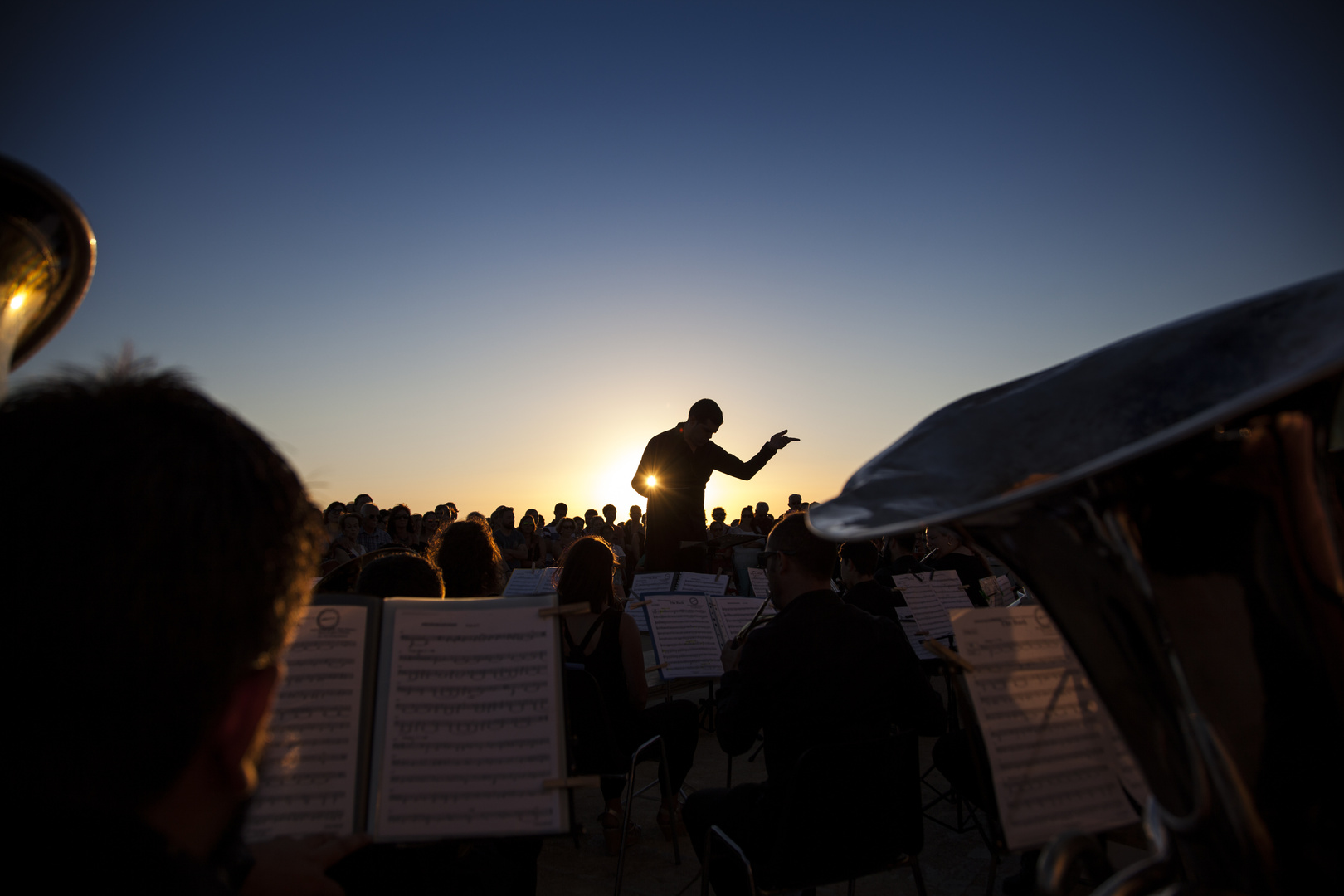 Philharmonic orchestra concert at sunset in southern Spain